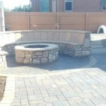 Fire pit with flagstone bench.