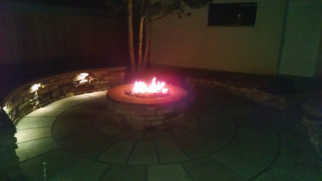 Custom gas fire pit at night.